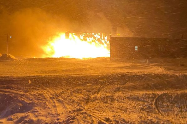 A fire destroyed the former school building in Chevak on Monday, March 8, 2021, causing power outages and leaving some homes without water and sewer. Two men have been missing since the blaze. Photo by Gretch Chayalkun