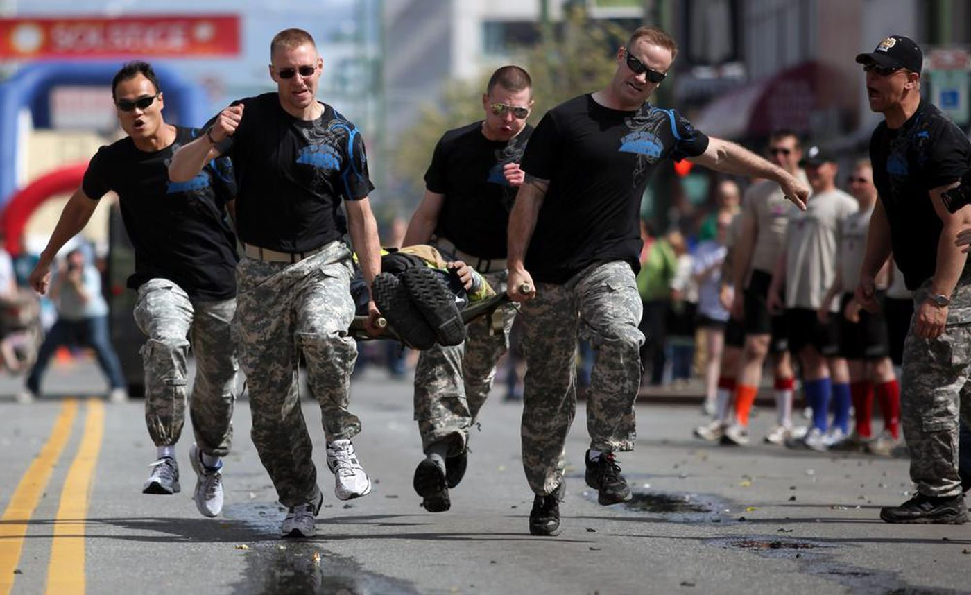 Members of the National Guard compete in the 3rd Annual Hero Games during the 2011 Summer Solstice Festival on 4th Avenue, from C Street to L Street, on Saturday, June 18, 2011.