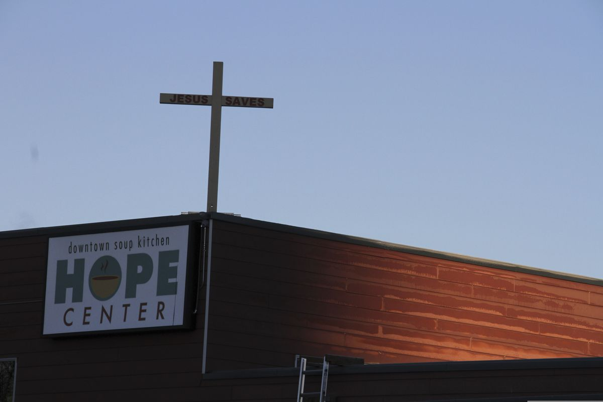 This Nov. 1, 2018, file photo shows the Hope Center women's shelter in downtown Anchorage, Alaska. The Municipality of Anchorage has settled a lawsuit brought by the faith-based Anchorage shelter, paying $100,001 and allowing Hope Center to deny shelter to transgender women. (AP Photo/Mark Thiessen,File)