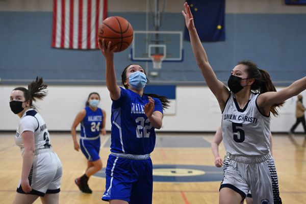 Newhalen junior Johnna Nanalook puts up a shot during the Malemutes' 55-27 victory over the Archangels in the opening round of the Girls 1A state basketball tournament at Palmer Junior Middle School on Thursday, April 1, 2021. (Bill Roth / ADN)