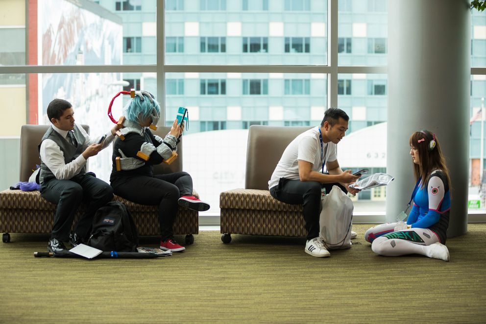Attendees take a break during Senshi Con Saturday. (Loren Holmes / ADN)