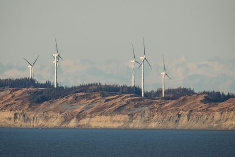 Wind turbines spin on Fire Island near Anchorage on Wednesday morning, October 29, 2014.