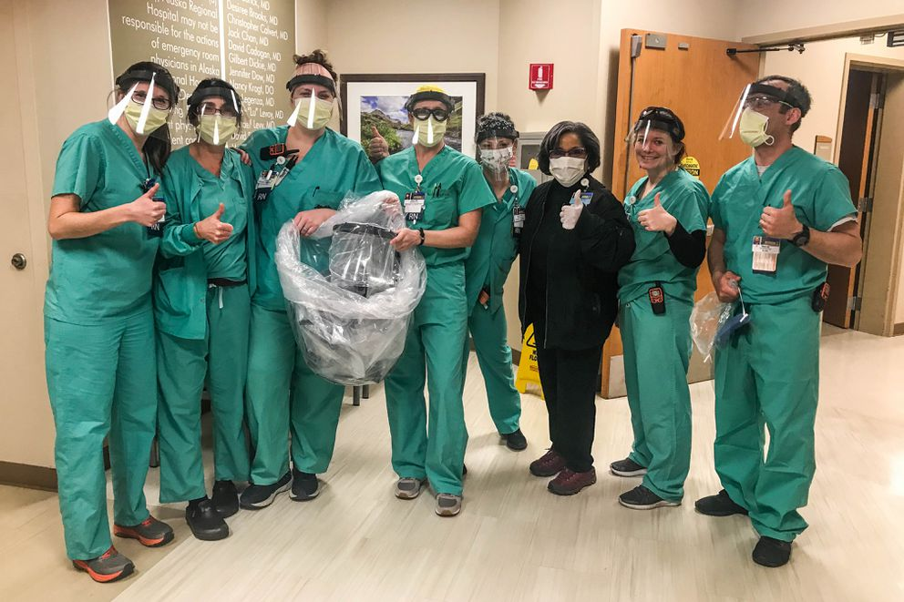 Members of the Alaska Regional Hospital emergency room staff try on face shields donated by Perfectionist Auto Sound on Saturday, March 28, 2020 in Anchorage. Perfectionist owner John Schwartz has a goal of making 500 of the shields, and so far has distributed about 200 to local hospitals. (Courtesy Cheryl Jones)