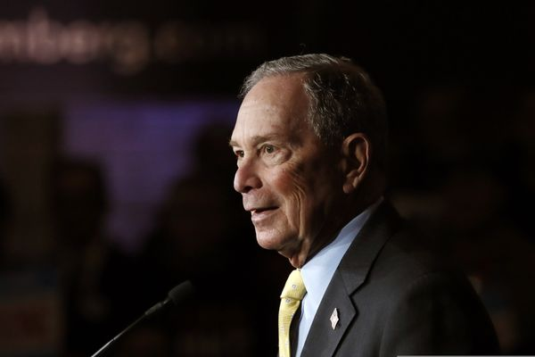 FILE - In this Tuesday, Feb. 4, 2020, file photo, Democratic presidential candidate and former New York City Mayor Michael Bloomberg talks to supporters, in Detroit. Bloomberg won the votes of New Hampshire's Dixville Notch community, hanging onto its tradition of being among the first to cast ballots in the presidential primary, early Tuesday, Feb. 11. (AP Photo/Carlos Osorio, File)