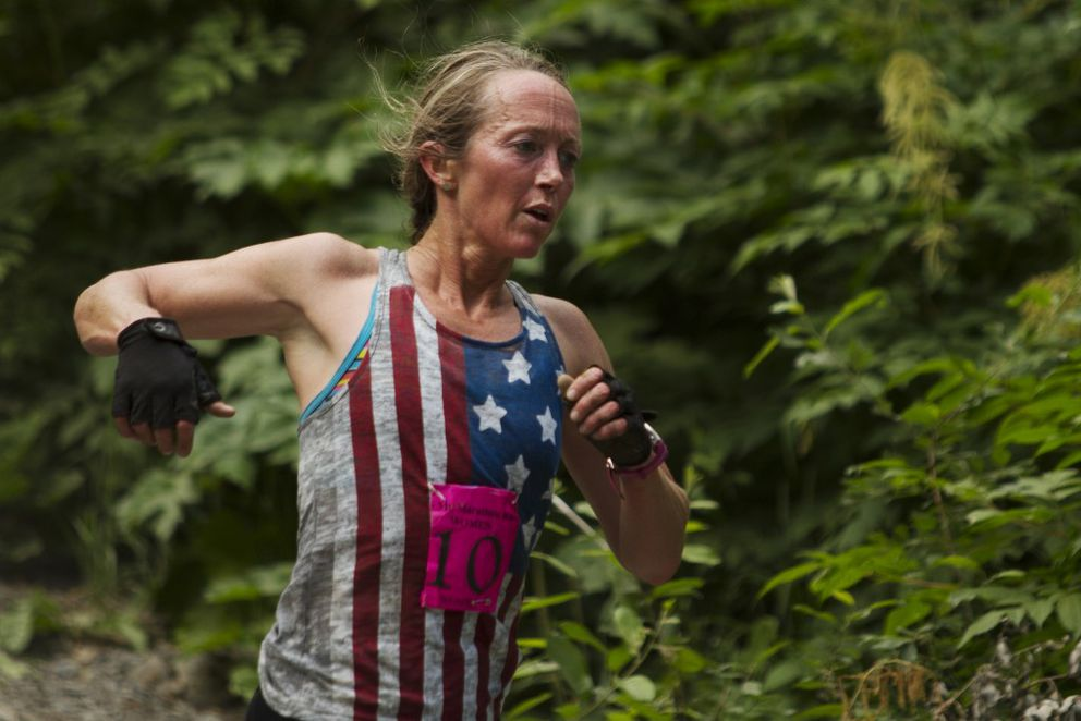 Wendy Sailors runs down Mount Marathon during the women's division at the Mount Marathon Race in Seward on Monday, July 4, 2016. (Sarah Bell / Alaska Dispatch News)