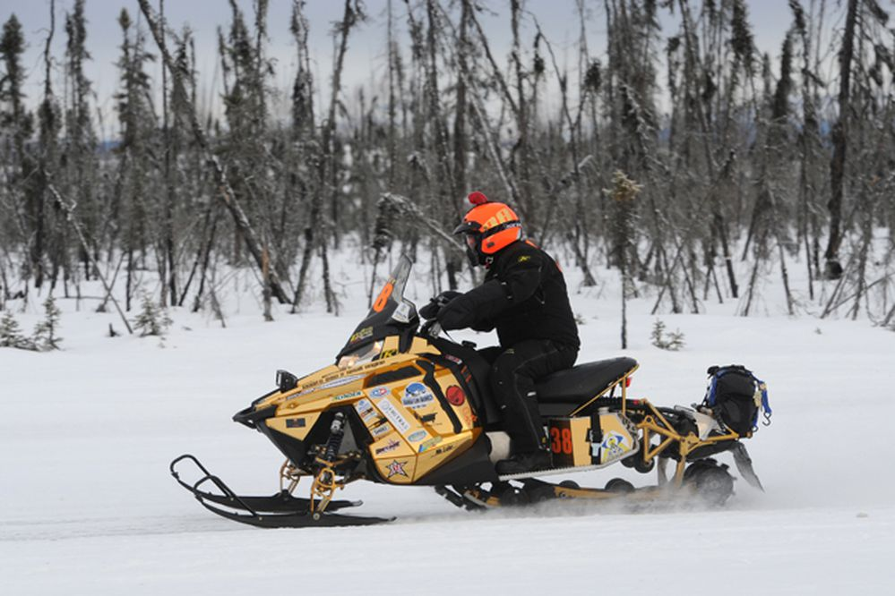 BILL ROTH / Anchorage Daily News Start of the Iron Dog, the world's longest and toughest snowmobile race, on the ice at Big Lake on Sunday, Feb. 16, 2014. Thirty-seven two-person teams will cover more than 2,000 miles of Alaska wilderness on their way to Nome with a Fairbanks finish next Saturday.