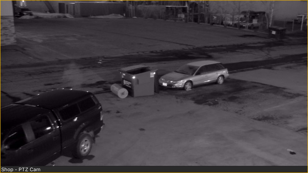 Security camera photos of someone dumping off a water heater at Chad Winberg's A2D Motorsports shop in south Anchorage, AK on Sunday April 15, 2018. (Chad Winberg photo)