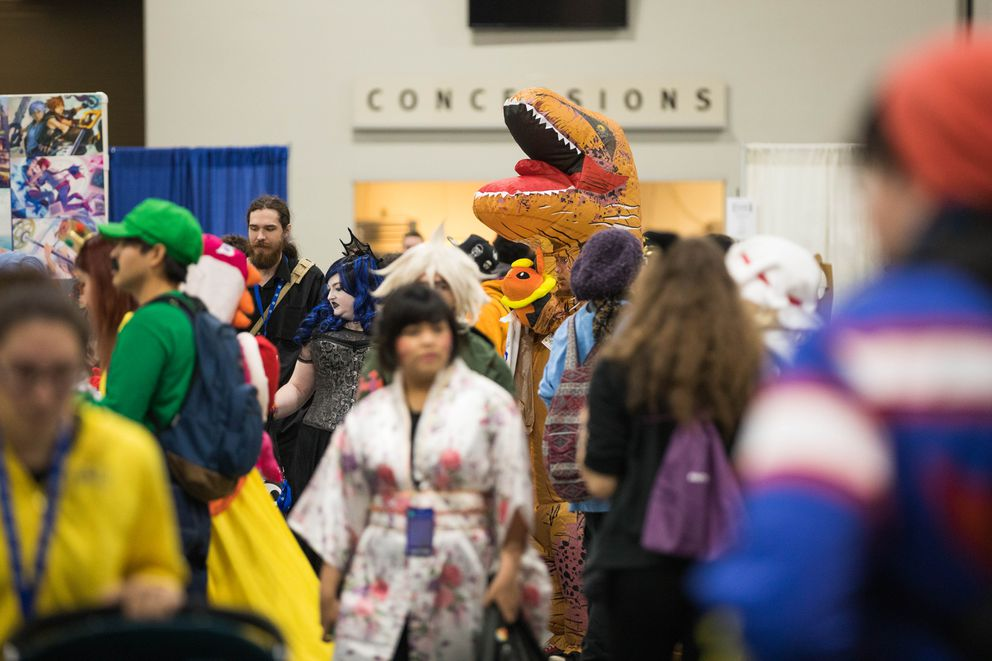 Cosplayers walk through the Dena'ina Civic and Convention Center Saturday during Senshi Con. (Loren Holmes / ADN)