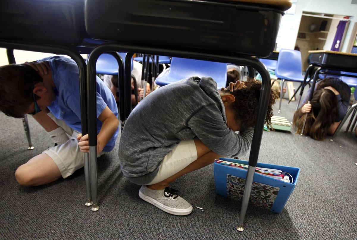 Sixth-graders take cover under their desks at the beginning of an earthquake drill at Pasadena Christian School in 2014. (Michael Robinson Chavez/Los Angeles Times/TNS)