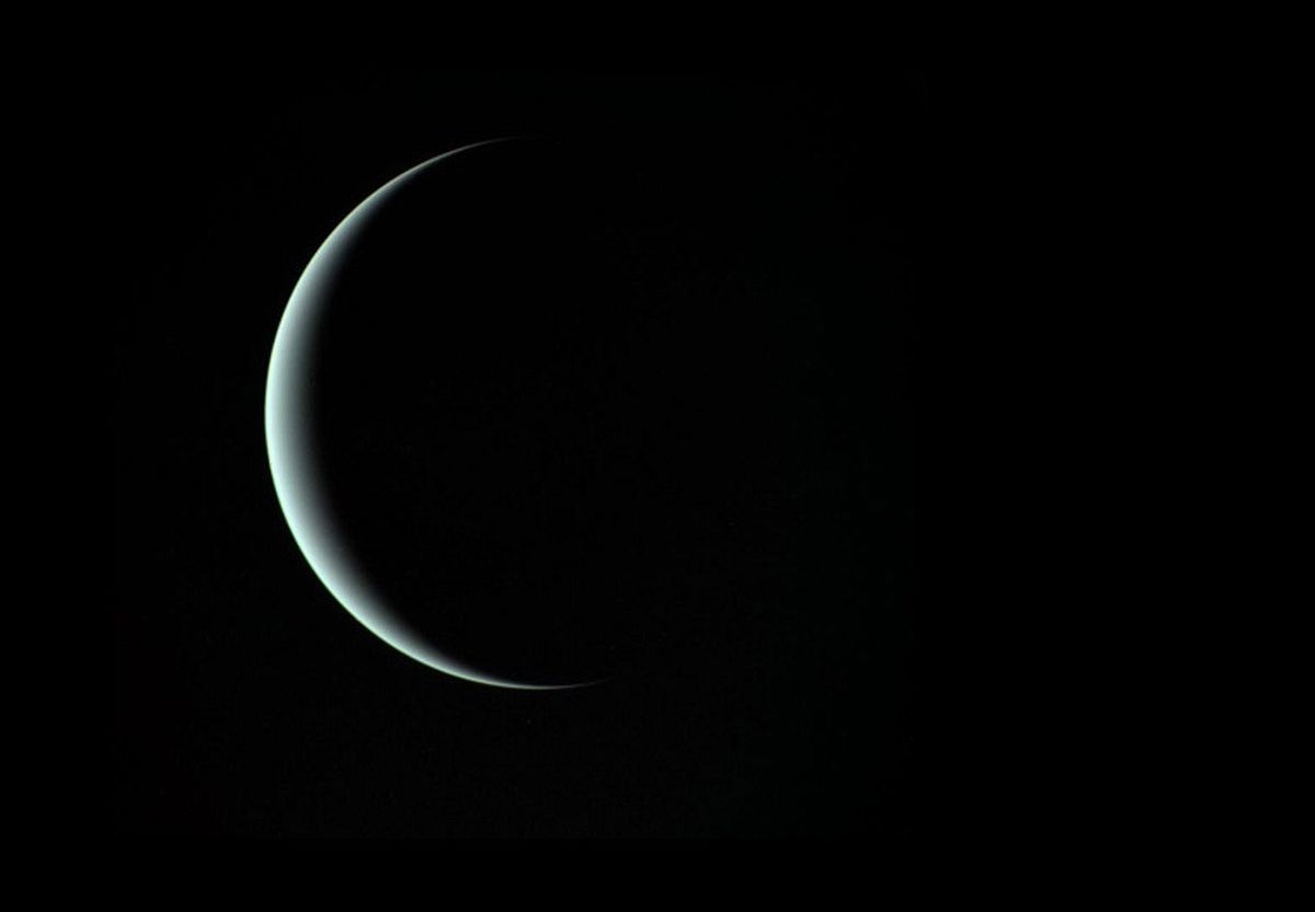 This image of a crescent Uranus, taken by Voyager 2 on January 24, 1986, reveals its icy blue atmosphere.  NASA/JPL