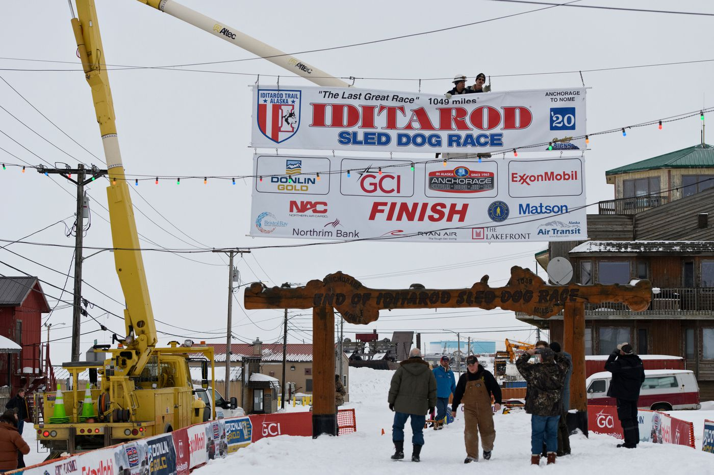 A banner marking the Iditarod finish line is hung over Front Street in Nome. (Marc Lester / ADN)