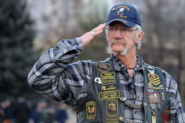Vietnam veteran Charles Hermans, from Glennallen, salutes during the Anchorage Veterans Parade at the Delaney Park Strip in Anchorage, Alaska on Saturday, Nov. 4, 2017. Hermans, with the Combat Veterans Motorcycle Association, will participate in ceremonies at the Veterans Wall of Honor in Wasilla on Saturday, Nov. 11, 2017. (Bob Hallinen / Alaska Dispatch News)