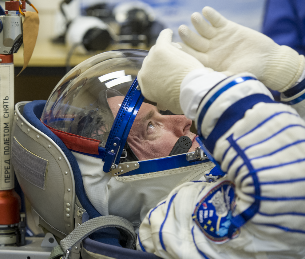 NASA Astronaut Scott Kelly is seen as he and his fellow crew members have their Russian sokol suits pressure checked ahead of their launch onboard the Soyuz TMA-16M spacecraft to the International Space Station Friday, March 27, 2015 in Baikonor, Kazakhstan. NASA