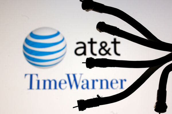 Coaxial TV Cables are seen in front of AT&T and Time Warner logos in this picture illustration taken June 13, 2018. REUTERS/Dado Ruvic/Illustration