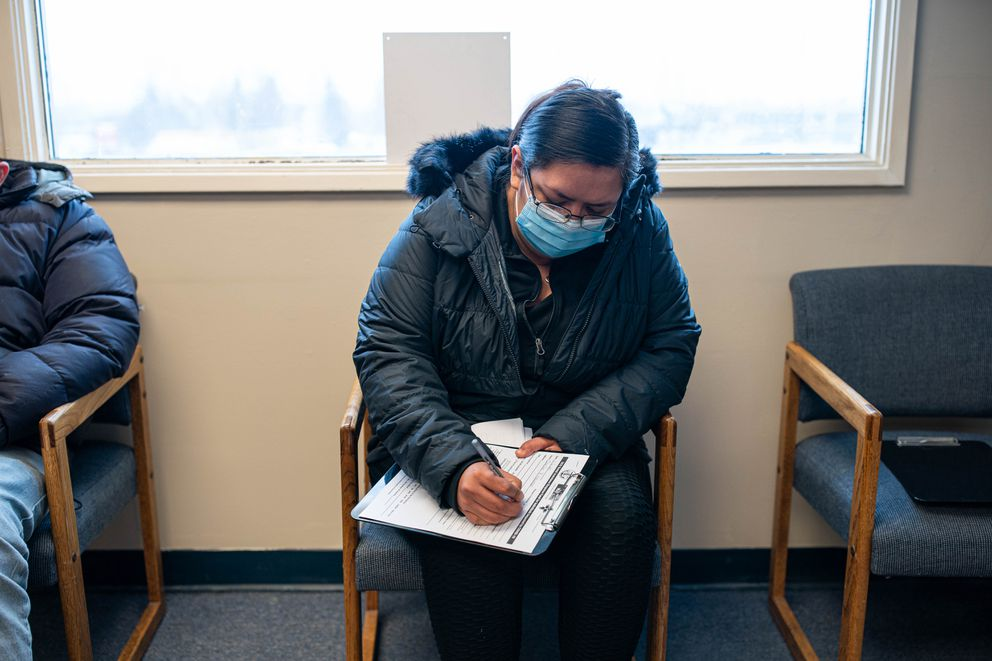 "Carolee Newman fills out a rental assistance application at Lutheran Social Services on Friday, Nov. 6, 2020 in Spenard. Newman received two months worth of assistance. ""Maybe my kids will have a decent Christmas, ' she said. (Loren Holmes / ADN)"