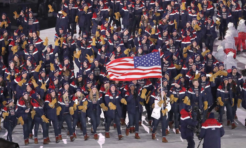 Erin Hamlin of Team USA carries the flag during the opening ceremony. REUTERS/Kim Kyung-Hoon