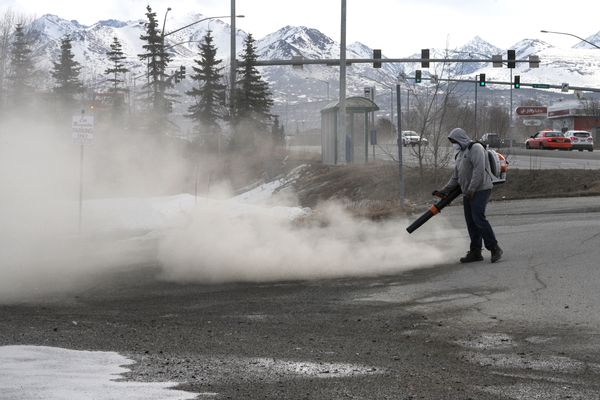 Marco Tafolla, of Avalanche Snow & Lawn, removes a winter's worth sand from the parking lot at Las Margaritas Mexican & Italian restaurant off Dimond Boulevard on Wednesday, April 11, 2018. (Bill Roth / ADN)