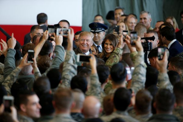 U.S. President Donald Trump and first lady Melania Trump pose for pictures after addressing members of U.S. military services and Japan Self-Defense Force (JSDF) at U.S. Air Force Yokota Air Base in Fussa, on the outskirts of Tokyo, Japan, November 5, 2017. REUTERS/Toru Hanai
