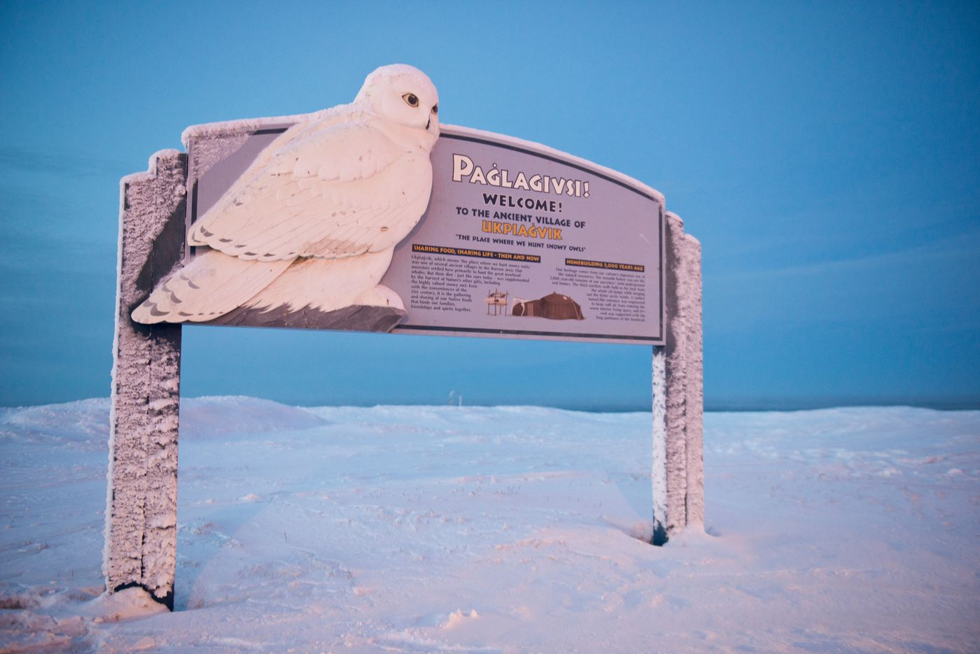 """A sign on the city's west side labels the areaUkpiaġvik and says the word means """"the place where we hunt snowy owls."""" Some residents say that term, not Utqiaġvik, is the proper Inupiaq place name. (Marc Lester / Alaska Dispatch News)"""