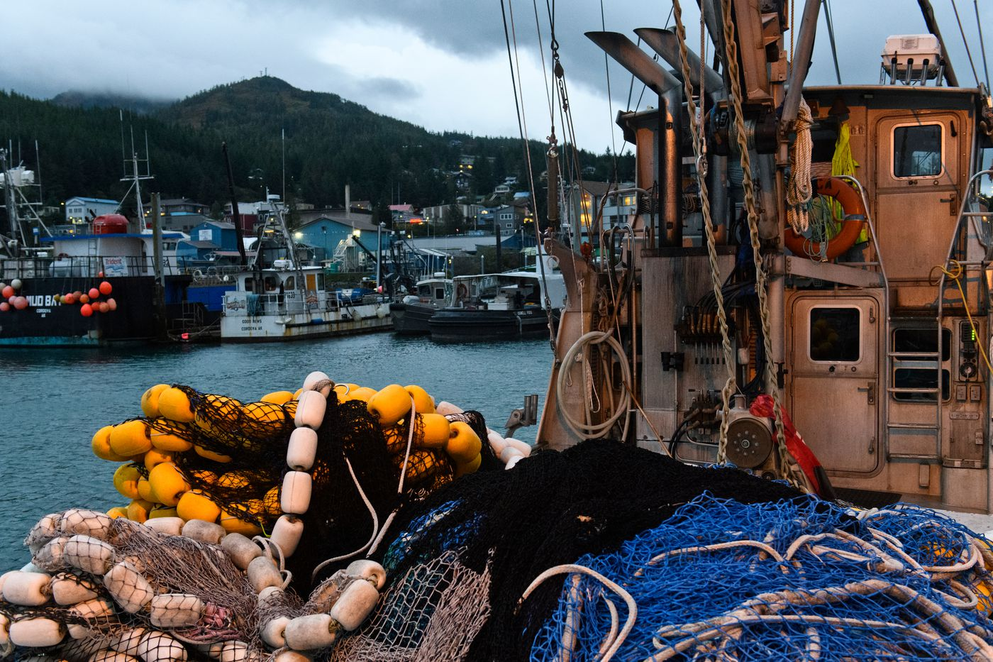 Fishing boats, some piled with nets, take up much of the Cordova boat harbor. (Marc Lester / ADN)