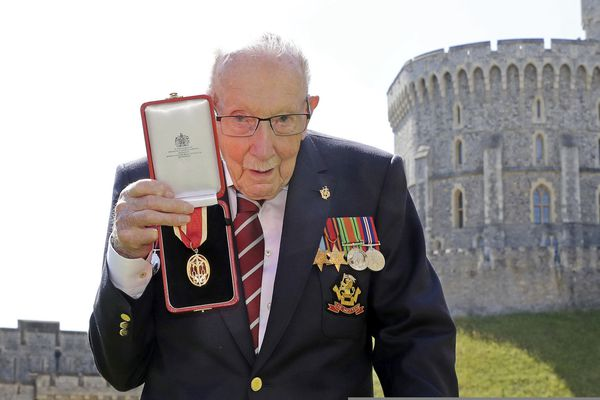 FILE - In this Friday, July 17, 2020 file photo, Captain Sir Thomas Moore poses for the media after receiving his knighthood from Britain's Queen Elizabeth, during a ceremony at Windsor Castle in Windsor, England. Tom Moore, the 100-year-old World War II veteran who captivated the British public in the early days of the coronavirus pandemic with his fundraising efforts, has died, Tuesday Feb. 2, 2021. (Chris Jackson/Pool Photo via AP, File)