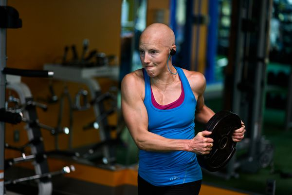 Kikkan Randall works out at an Alaska Club on October 2, 2018. Randall said it was a priority to stay active during the course of her cancer treatment. (Marc Lester / ADN)