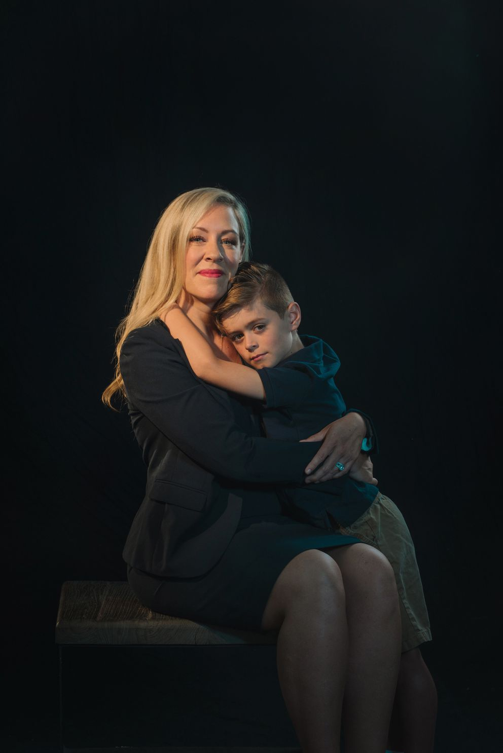 Rachel Mountis, who is part of a lawsuit accusing Merck of paying women less than men and denying them professional opportunities, with son Max, age 7, at her home in Mount Pleasant, S.C., May 12, 2018. (Mike Belleme/The New York Times)