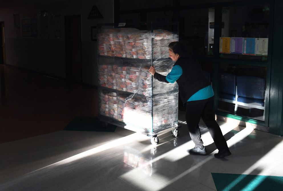 Van Nugen pushes a cart of lunches as she and others from Weyanoke Elementary School in Alexandria, Va., distribute food to students while the school is closed. Washington Post photo by Matt McClain
