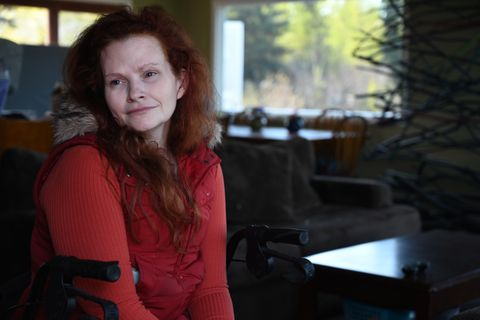 Sherri Stewart (previously Patterson) sits at her front door for a portrait, May 20, 2020. (Anne Raup / ADN)