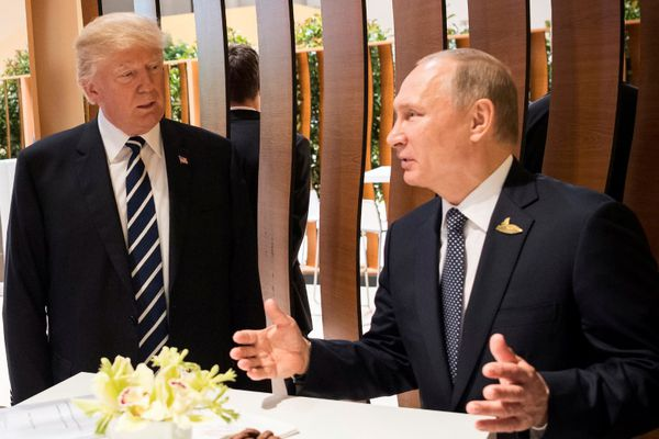 U.S. President Donald Trump, Russia's President Vladimir Putin and President of the European Commission Jean-Claude Juncker talk during the G20 Summit in Hamburg, Germany in this still image taken from video, July 7, 2017. REUTERS/Steffen Kugler/Courtesy of Bundesregierung/Handout via REUTERS