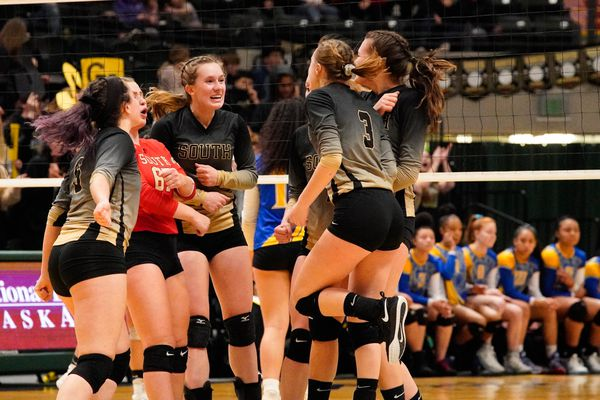 South celebrates a point Saturday, Nov. 16, 2019 during the 4A State Volleyball Championship against Bartlett at the Alaska Airlines Center. (Loren Holmes / ADN)