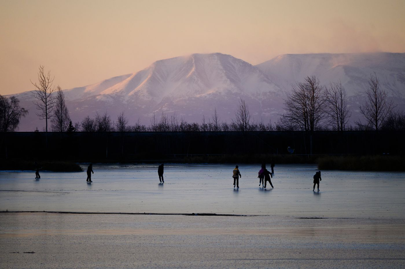 Ice skaters glide on Westchester Lagoon in this view that includes Mount Susitna on November 1, 2020. (Marc Lester / ADN)
