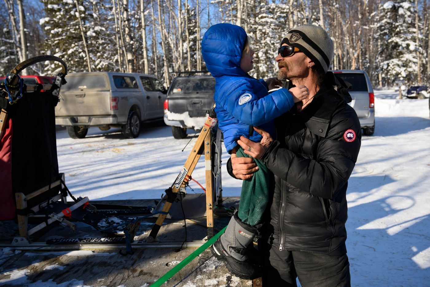 Fairbanks musher Lance Mackey holds his 3-year-old son, Atigun, in Wasilla on March 4, 2020. (Marc Lester / ADN)