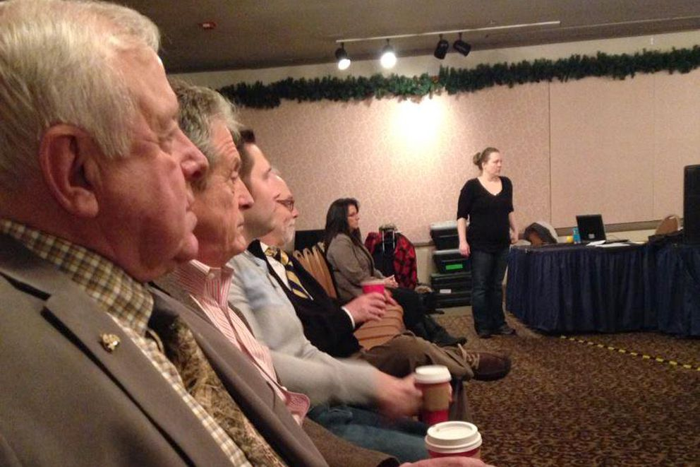 Roland Maw, left, sits at a meeting of the Alaska fish and game boards January 14, 2015, at the Baranof Hotel in Juneau. (Nathaniel Herz / ADN archive)