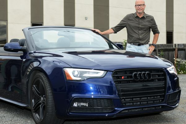 Tom Dreyer's 2015 Audi S5 Cabriolet convertible is listed on the car-sharing site Turo.com. He has already shared his car twice since he listed it two weeks ago. He was photographed on Tuesday, August 1, 2017, downtown. (Erik Hill / Alaska Dispatch News)