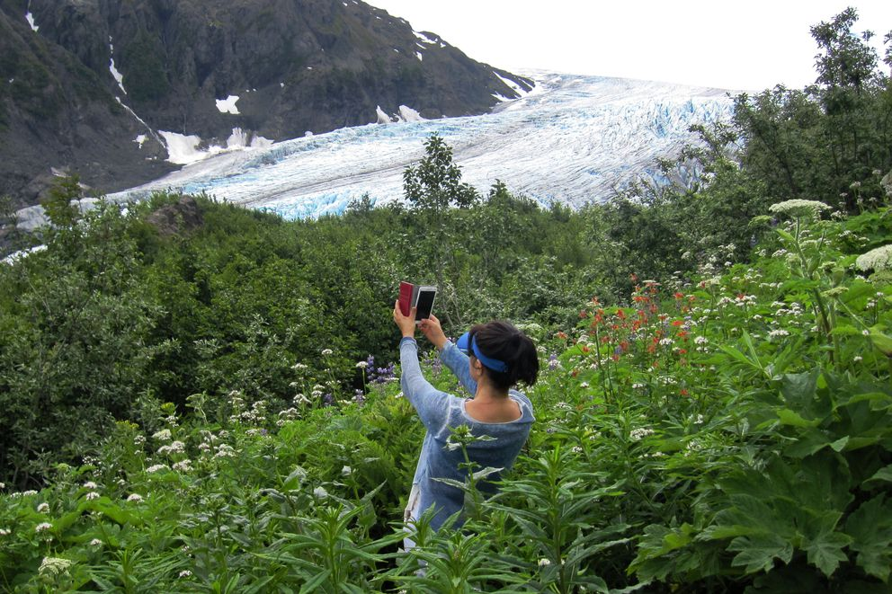 Linda Keys, visiting from Korea, takes photos of Exit Glacier from the lower level of the Harding Icefield Trail in Seward. (Yereth Rosen / ADN archive)