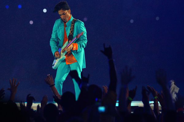 Prince performs in the halftime show at Super Bowl XLI in Miami Gardens, Fla., Feb. 4, 2007. Prince Rogers Nelson, the singularly flamboyant and prolific songwriter and performer whose decades of music — 39 albums in all — transcended and remade genres from funk and rock to R&B, died on April at Paisley Park, his recording studio and estate outside Minneapolis on April 21, 2016. He was 57.