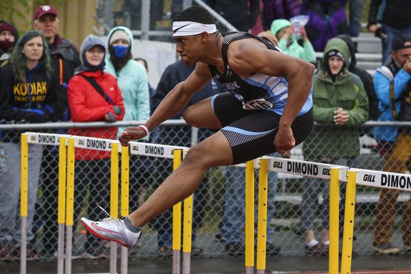 Chugiak's Logan Mathieu clears a hurdle as he competes in the division one men's 110m hurdle, finishing with a time of 14.74 seconds, during the track and field state championships hosted by ASAA at Dimond High School in Anchorage on Saturday, May 29, 2021. (Emily Mesner / ADN)