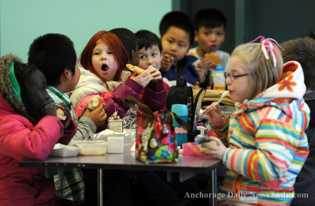 ERIK HILL / Anchorage Daily News Youngsters spend a busy 20 minutes eating and socializing during their lunch shift Wednesday October 17, 2012 at Scenic Park Elementary School. The school allots 20 minutes for lunch to each grade, from kindergarten through fifth grade, beginning at 11:40 a.m. for two hours.