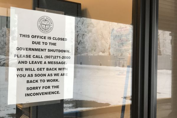 A sign on the door at the Federal Aviation Administration's Flight Standards District Office in Midtown Anchorage on Monday, Jan. 7, 2019. (Annie Zak / ADN)