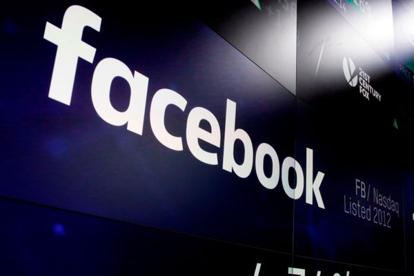 FILE - This March 29, 2018 file photo shows the Facebook logo on screens at the Nasdaq MarketSite in New York's Times Square. Facebook plummeted 19 percent Thursday, July 26, 2018, after warning of slower growth ahead, erasing more than $100 billion in value. (AP Photo/Richard Drew, File)
