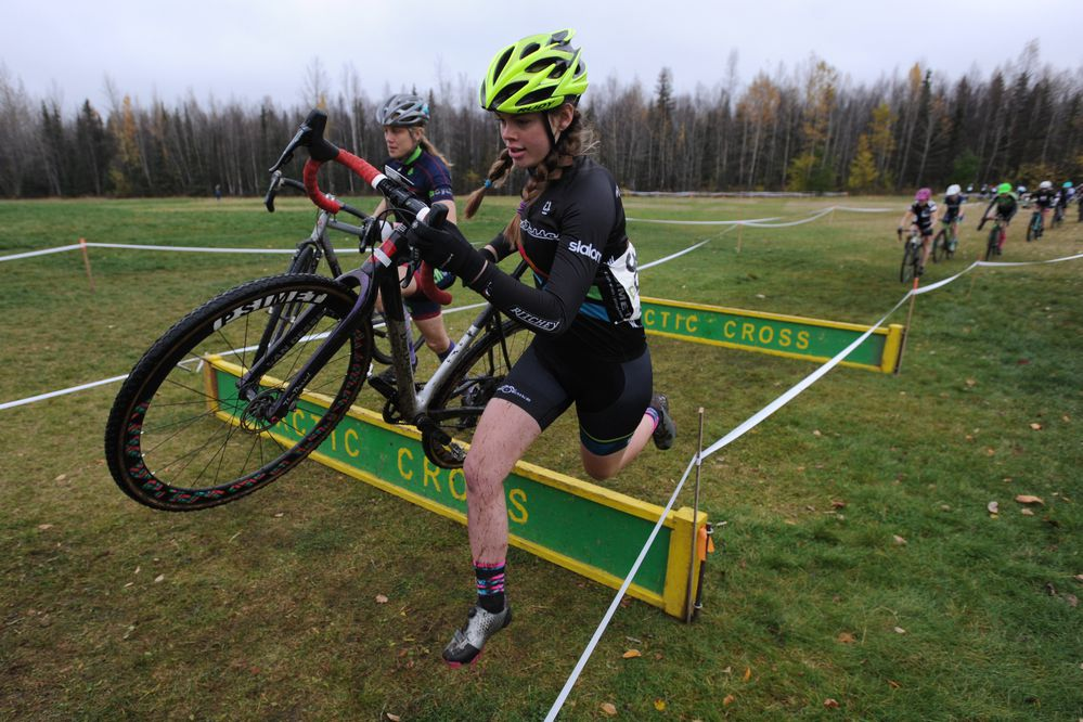 Ellie Mitchell leaps over a barrier during the Alaska Cyclocross Series Arctic Cross at APU on Sunday, Oct. 8, 2017. (Bill Roth / Alaska Dispatch News)