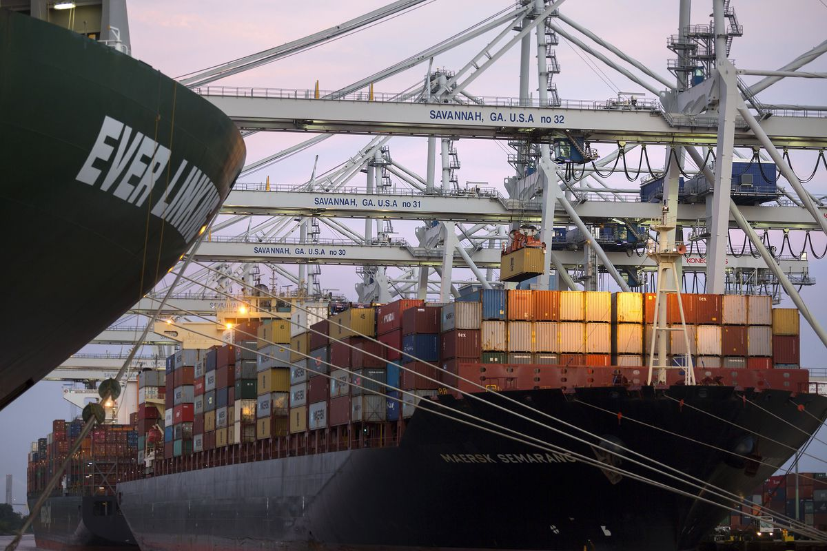 In this June, 19, 2018 photo, several ship to shore cranes stack shipping containers on-board the container ship Maersk Semarang at the Port of Savannah in Savannah, Ga. The U.S. has threatened to impose 25 percent duties on $34 billion in Chinese products starting Friday, July 6, and China has said it will fire back with corresponding tariffs. (AP Photo/Stephen B. Morton)