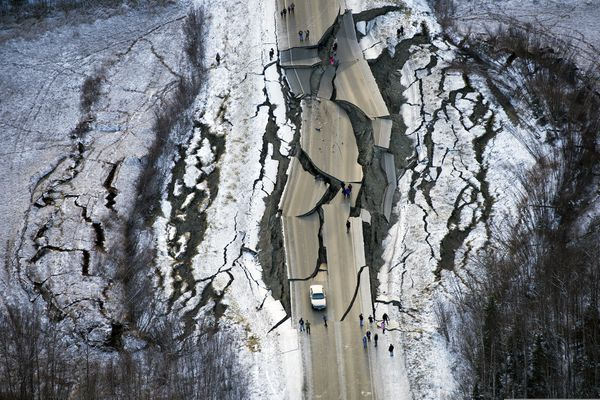 FILE - This Nov. 30, 2018 file photo shows a broken and twisted section of Vine Road south of Wasilla, Alaska, following an earthquake. Gov. Mike Dunleavy on Thursday, Jan. 3, 2019 requested a major disaster declaration from the federal government following the Nov. 30 earthquake that rocked Anchorage and other parts of south-central Alaska. Dunleavy says the declaration, if approved, would free up money to help the state recover more quickly. Initial damage estimates have been pegged around $100 million. (Marc Lester/Anchorage Daily News via AP, File)