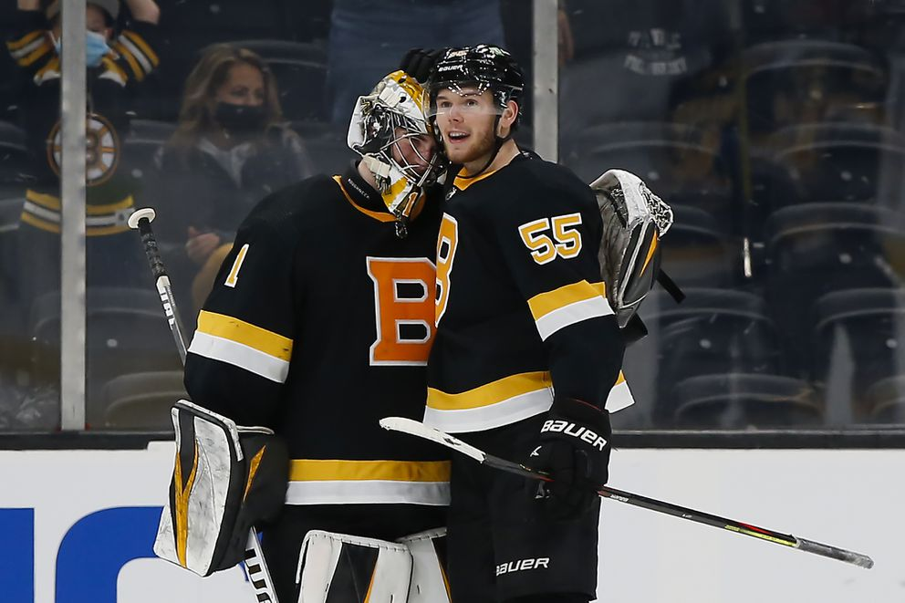 Jeremy Swayman, left, is congratulated by Jeremy Lauzon after a 3-0 shutout of the Islanders on Friday. (AP Photo/Winslow Townson)
