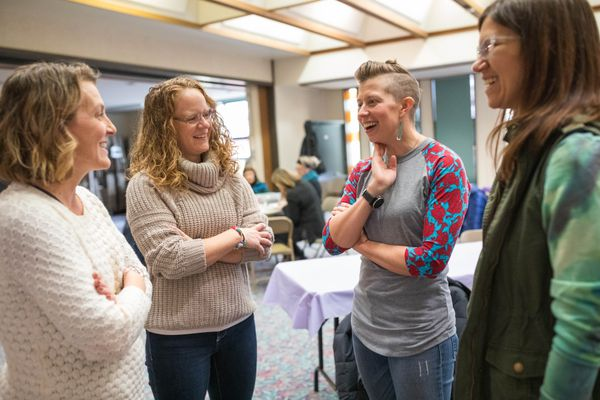 Annette Snedaker, second from left, chats with Tiffany Hall during a potluck honoring Snedaker Saturday, Nov. 3, 2018 at First Presbyterian Church in Anchorage. Snedaker lent her bike to Hall, who was a stranger to her, during the Great Floridian triathlon in October. Hall's bike had broken, and she thought that she wouldn't get to finish the 140.6 mile race. Hall used airline miles to bring Snedaker up to Alaska to thank her for the gesture of kindness. (Loren Holmes / ADN)
