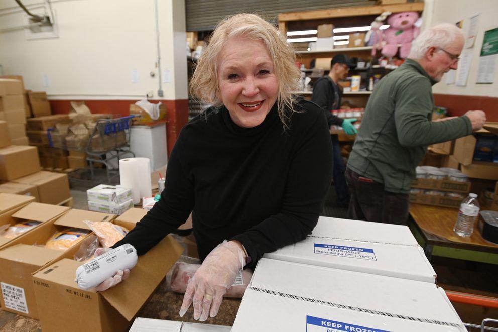 Volunteer Patti Lovett helped distribute food at the Lutheran Social Services of Alaska food pantry in Spenard on Wednesday, March 18, 2020. (Bill Roth / ADN)