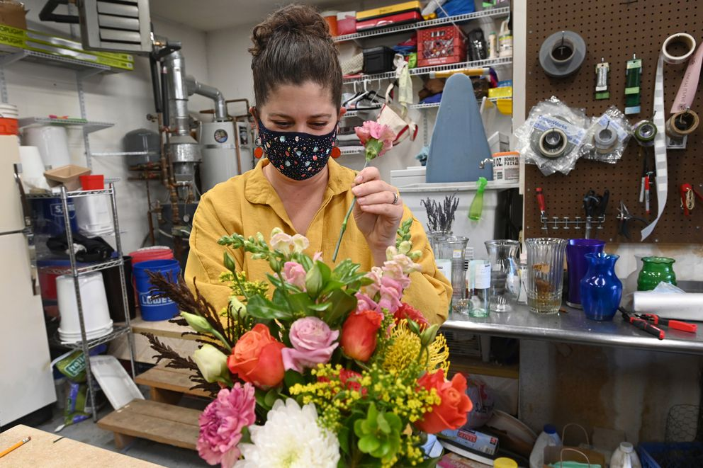 Florist Natasha Price makes a flower arrangement in her garage on Wednesday, Oct. 21, 2020. Price said her business Paper Peony is thriving during the pandemic. (Bill Roth / ADN)