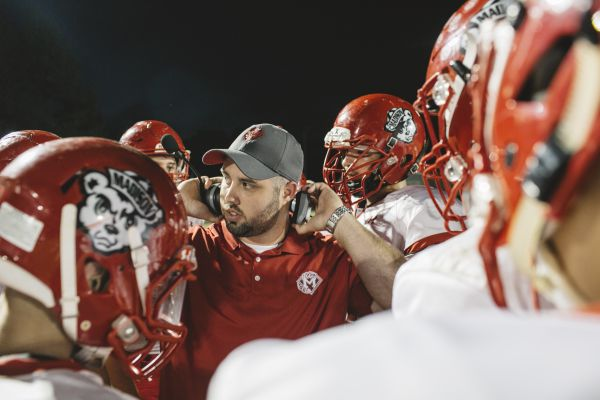 Patric Morrison coaches the Madison Cubs during a high school football playoff game in Sellersburg, Ind., Oct. 20, 2017. (Andrew Spear/The New York Times)