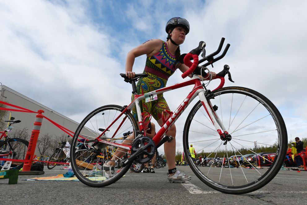 Valerie Goulet makes the transition from swim to bike. (Bill Roth / ADN)